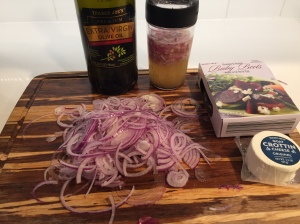 add olive oil to the dressing after marinating for 30 min. Other toppings are red onion, goat cheese and beets.